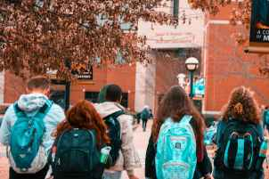 people wearing backpacks